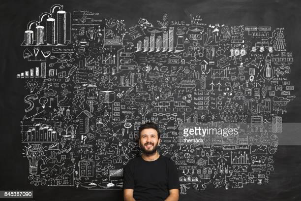 young man idea concept on blackboard - chalkboard stock photos and pictures