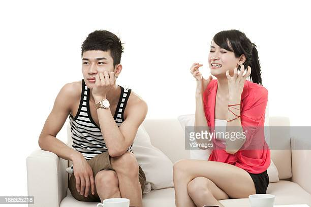 Young man ignoring aggravated girlfriend