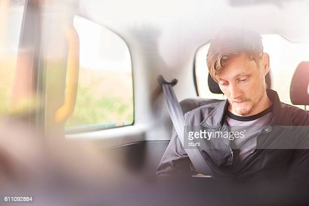 young man in a black cab