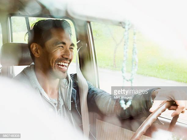young man in a car behind the steering wheel, driving. - stubble stock pictures, royalty-free photos & images