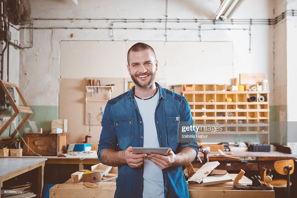 Young man in a carpentry workshop : Stock Photo