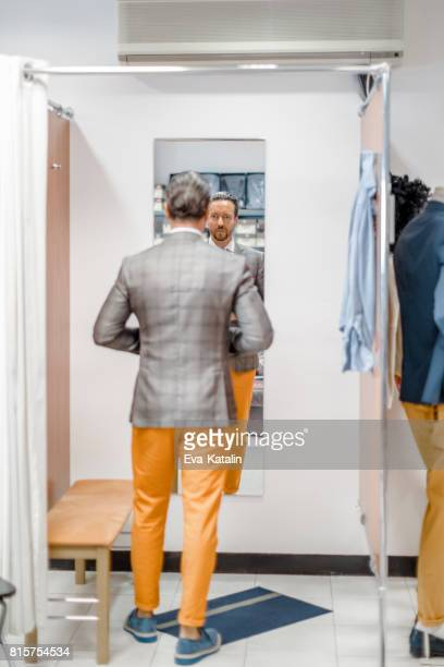young man in a fitting room - fitting room stock pictures, royalty-free photos & images