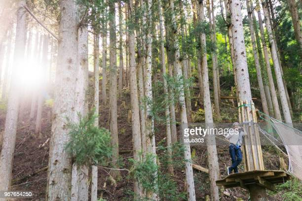 Young man in a forest obstacle course