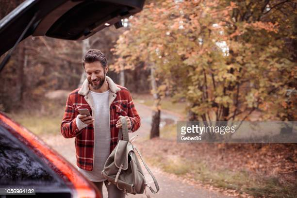 young man in a forest - masculinity stock pictures, royalty-free photos & images