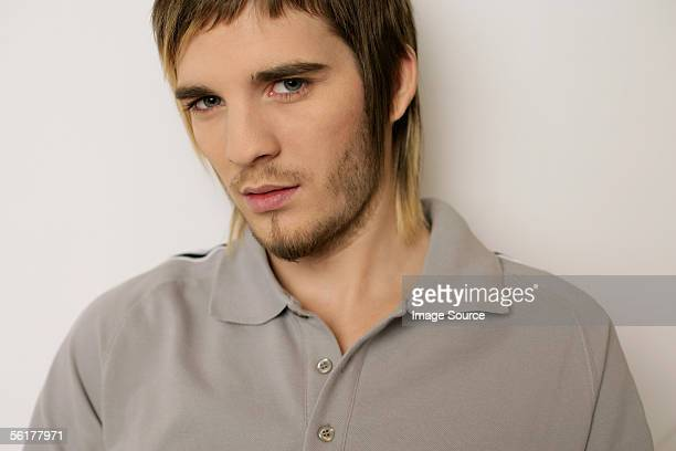 young man in a grey polo shirt - mullet stock photos and pictures