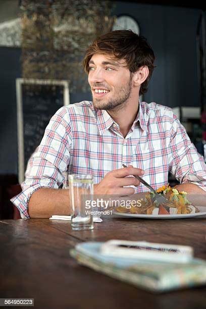 Young man in a restaurant having lunch