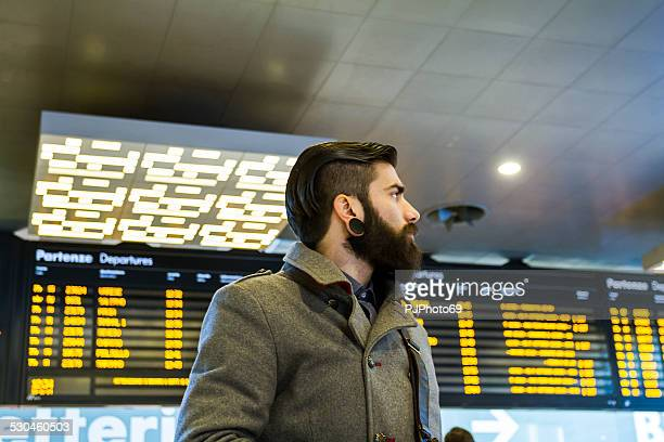 young man (stylish hipster) in a station or airport - pjphoto69 stock pictures, royalty-free photos & images