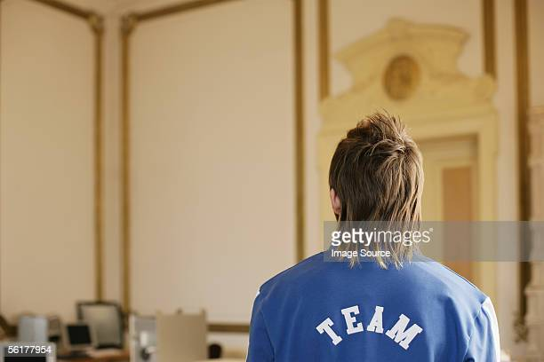 young man in an ornate room - mullet stock photos and pictures