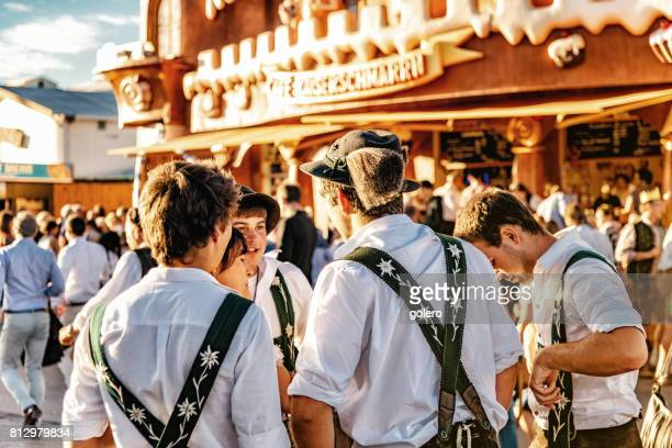 young man in bavarian clothe at oktoberfest in munich - oktoberfest stock pictures, royalty-free photos & images