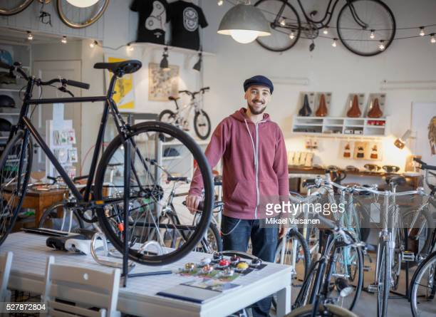 young man in bicycle shop