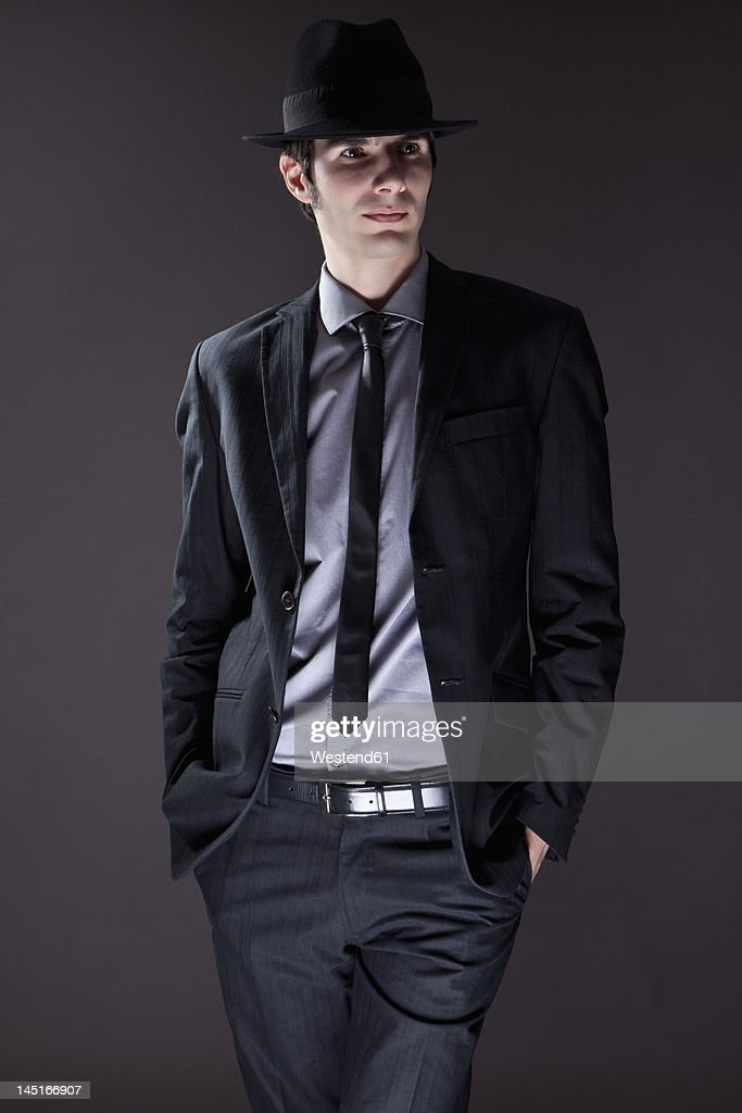 young man in black suit with hat ストックフォト getty images