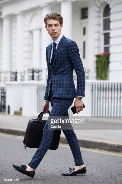 young man in blue checked suit walking across the road - loafer stock pictures, royalty-free photos & images