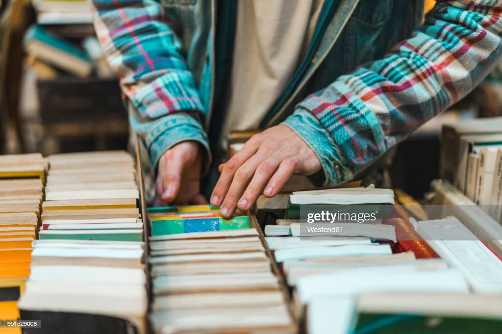 Young man in bookshop : Stock Photo