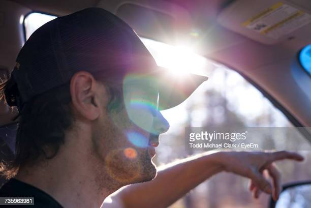 young man in car - stubble stock pictures, royalty-free photos & images
