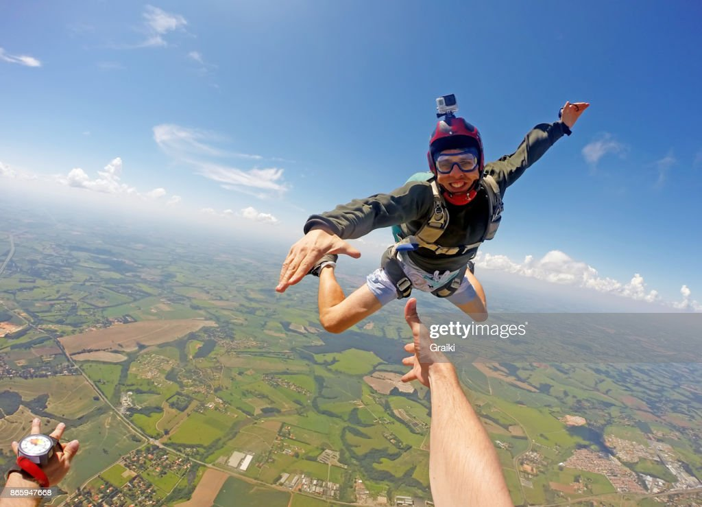 Boy in casual clothes jumping from parachute. : Stock Photo