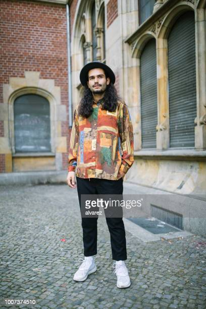 young man in casual outfit looking at camera - hippie stock pictures, royalty-free photos & images