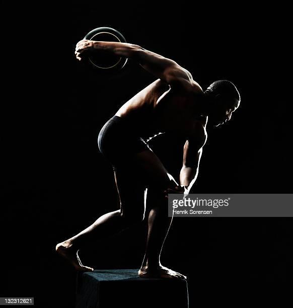 young man in classic . pose - olympische spelen stockfoto's en -beelden