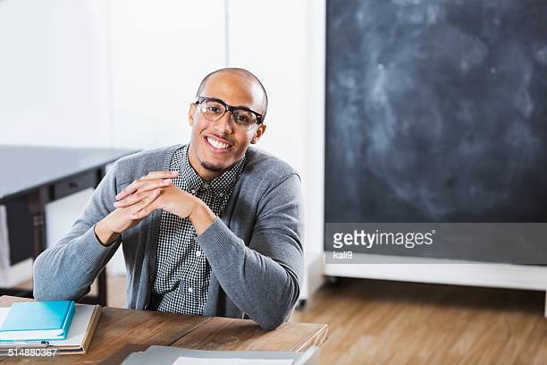 Young man in classroom or office