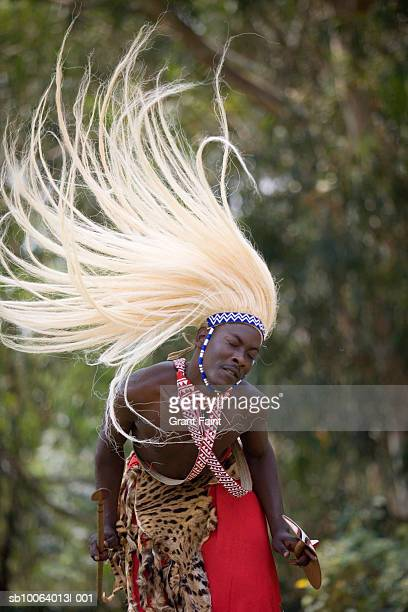 young man in costume performing traditional watusi dance - rwanda stock pictures, royalty-free photos & images