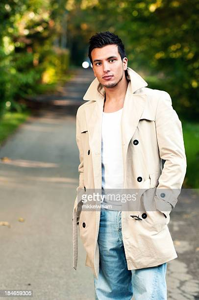 Young man in cotton coat outside