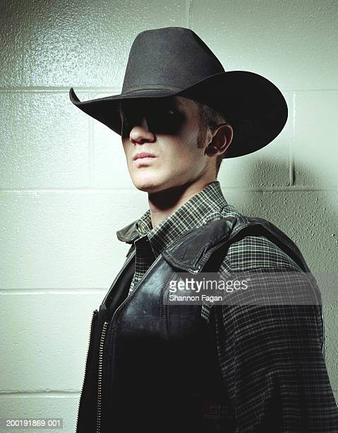 young man in cowboy hat and leather vest, portrait - cowboy stock pictures, royalty-free photos & images