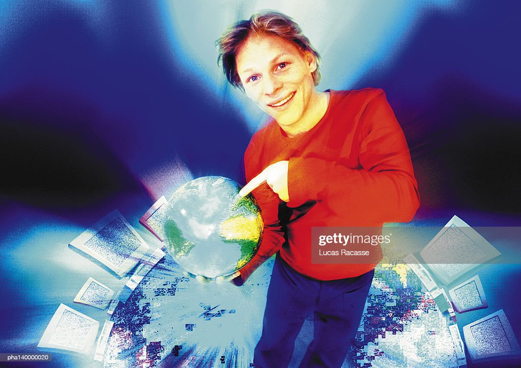 Young man in cyberspace pointing to world globe, digital composite. : Stockfoto