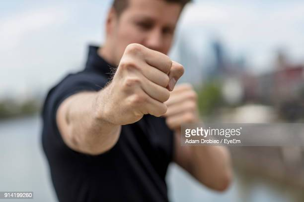 young man in fighting stance - fighting stance stock pictures, royalty-free photos & images