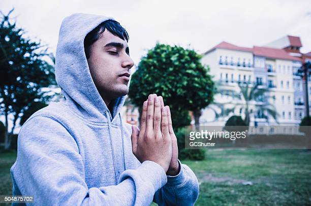Young man in focused yoga position