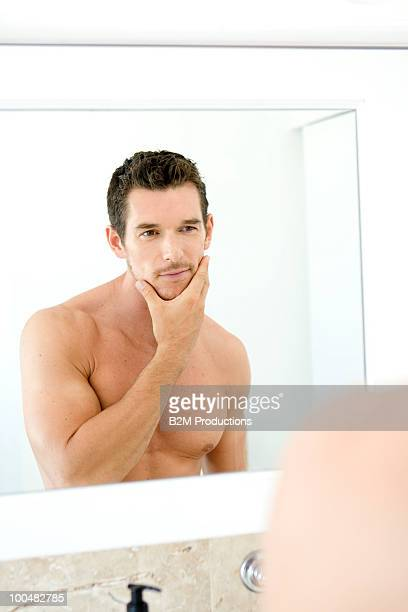Young man in front of a mirror