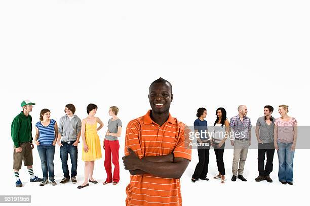 A young man in front of a row of men and women
