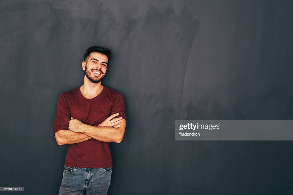 Young man in front of blackboard : Stock Photo