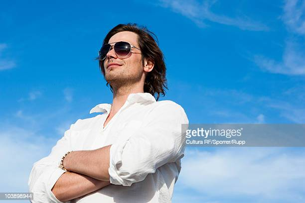 young man in front of blue sky - arrogance stock pictures, royalty-free photos & images
