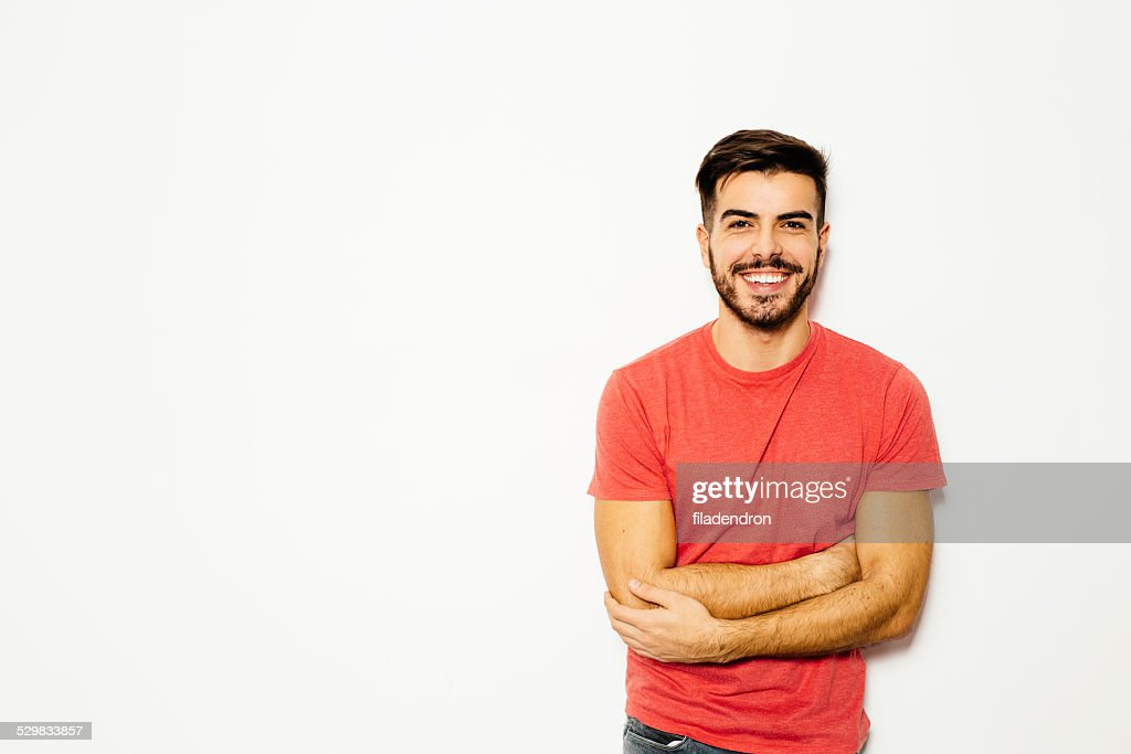 Young man in front of  white background : Stock Photo