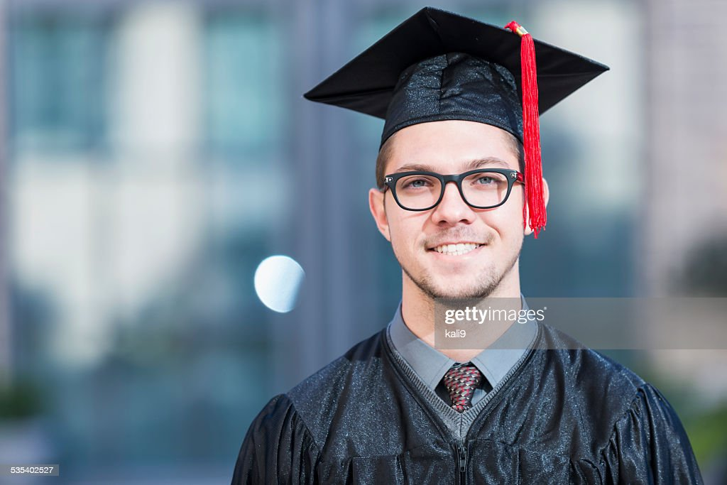 Young Man In Graduation Cap And Gown Stock Photo | Getty Images