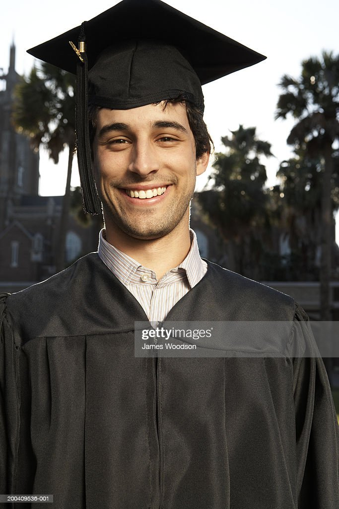 Young Man In Graduation Cap And Gown Smiling Portrait Closeup Stock ...