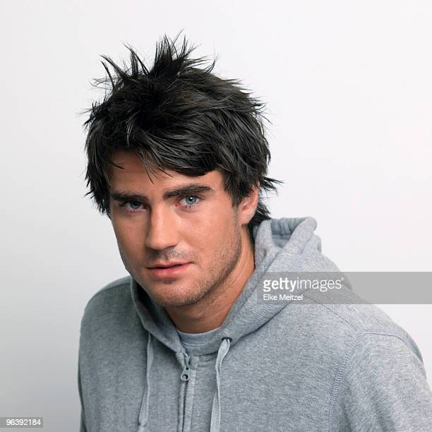 Young man in grey hooded top
