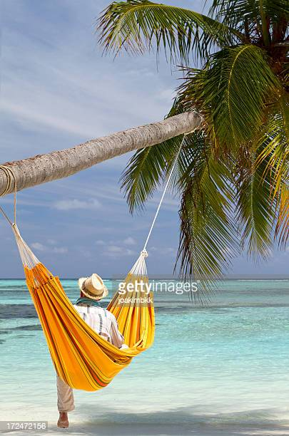Young man in hammock on the beach