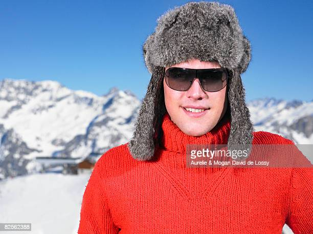 young man in hat at mountains - fur hat stock photos and pictures