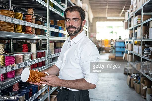 young man in his artisanal handicraft traditional textile factory - textile industry stock pictures, royalty-free photos & images