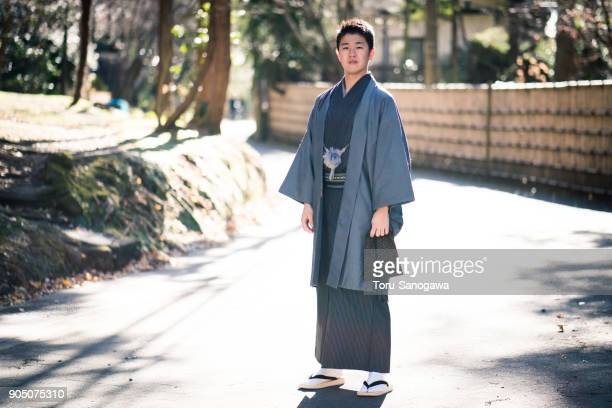 young man in kamakura - kimono stock pictures, royalty-free photos & images
