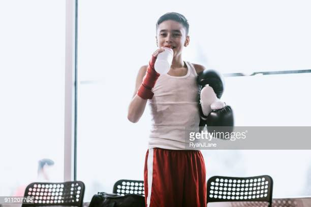 young man in kickboxing training center - mixed martial arts stock pictures, royalty-free photos & images