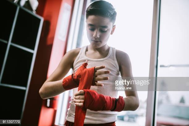Young Man In Kickboxing Training Center