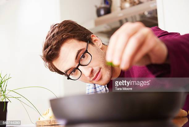 Young man in kitchen at home cooking