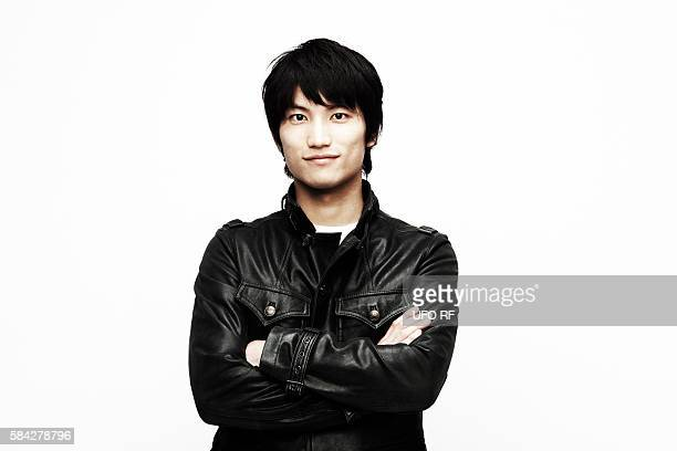 young man in leather jacket - レザージャケット ストックフォトと画像