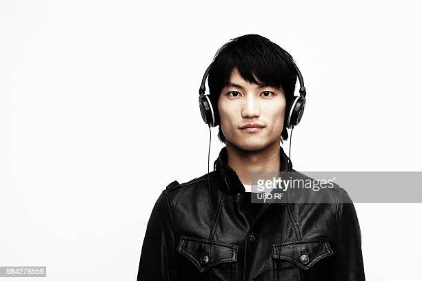 Young man in leather jacket with headphones