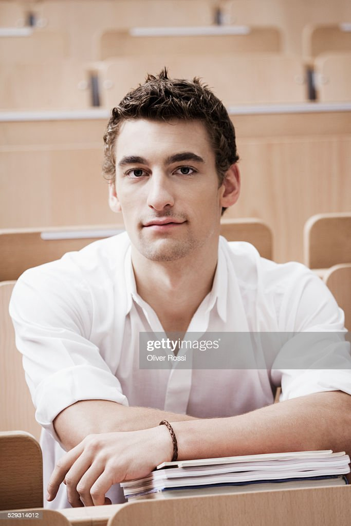 Young man in lecture hall : ストックフォト