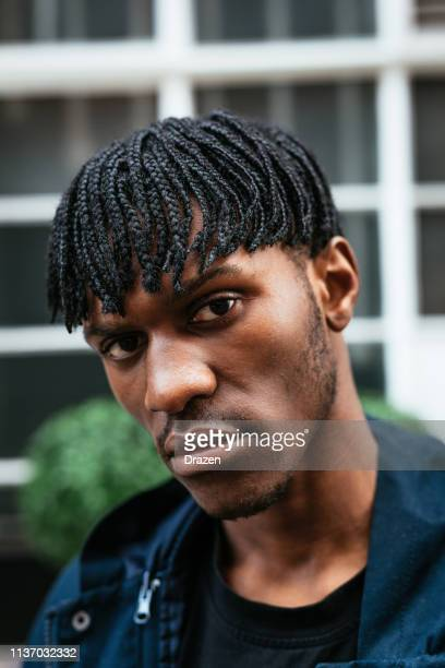 Young man in London with dreadlocks