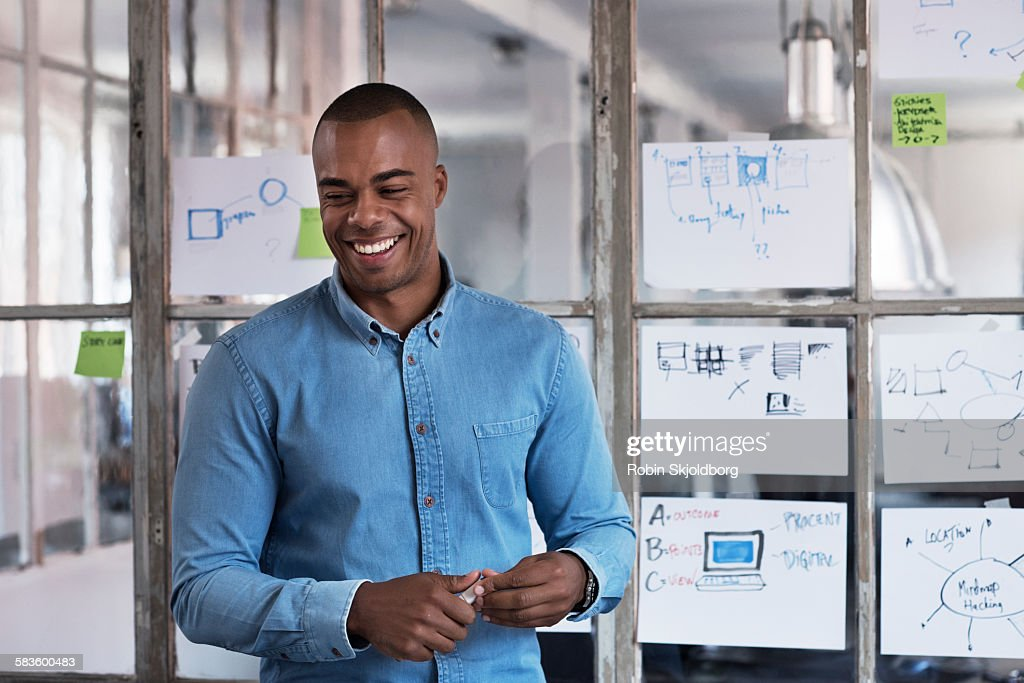 Young Man in meeting room smiling : Stock Photo