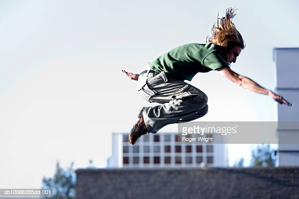 Young man in mid air, outdoors