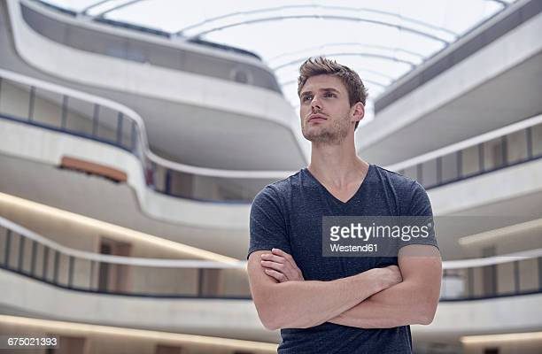 Young man in modern office building